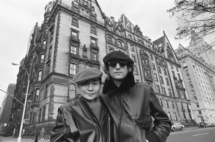 Left: YOKO ONO, BORN: 1933, Right: JOHN LENNON 1940-1980 in front of THE DAKOTA in NEW YORK CITY